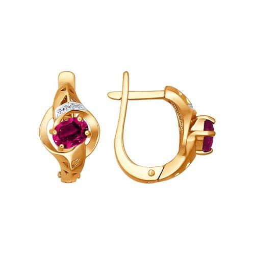 Женские золотые серьги украшенные бриллиантами и рубином