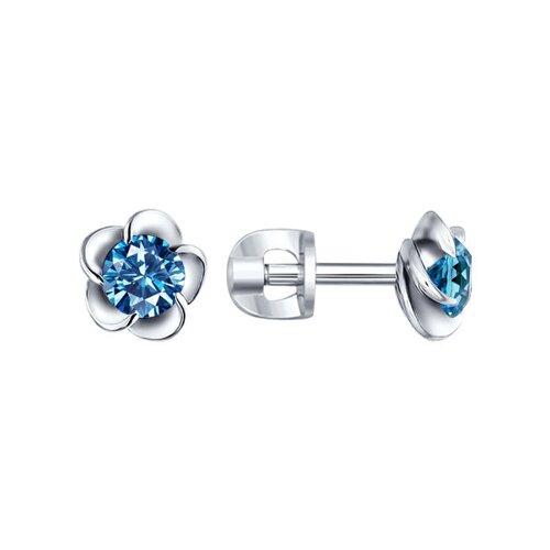 Серьги-гвоздики из серебра в виде цветка с голубым фианитом