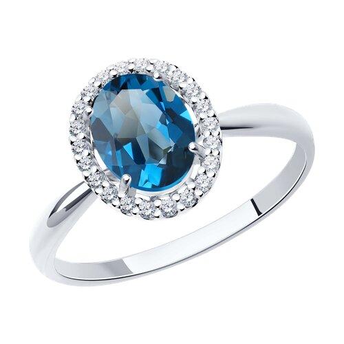 Кольцо из белого золота с синим топазом и фианитами