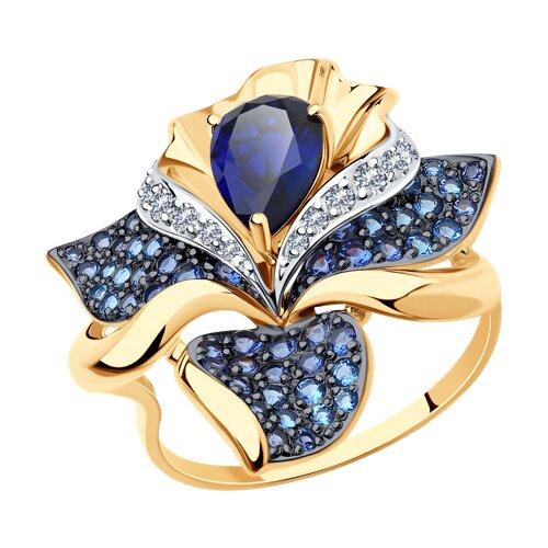 Кольцо из золота с синим корунд (синт.) и бесцветными, голубыми и синими фианитами