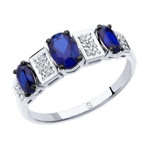 Кольцо из белого золота с бриллиантами и синими корунд (синт.) (6012144) - фото
